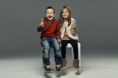 A portrait of a girl and a smiling boy. Thumbs up Royalty Free Stock Photos