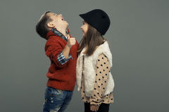 A portrait of a girl and a smiling boy. Thumbs up Royalty Free Stock Image