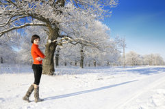 Portrait of the girl on a snow-covered forest Royalty Free Stock Image