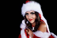 Portrait of a girl snow maiden. Girl in the image of the Snow Maiden in a Santa Claus hatn stock image