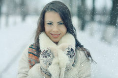 Portrait of a girl in snowy park Royalty Free Stock Image
