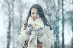 Portrait of a girl in snowy park Stock Images