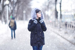 Portrait of a girl in a snowy winter park Stock Photography