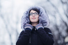 Portrait of a girl in a snowy winter park Royalty Free Stock Photo