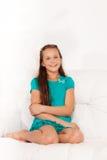 Portrait of girl on sofa Stock Photos