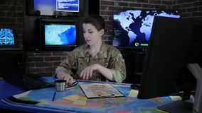 Portrait girl soldier in uniform, in Military headquarters, system control center, manages station and discussing battle stock video footage
