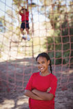 Portrait of girl standing with arms crossed during obstacle course Stock Photos