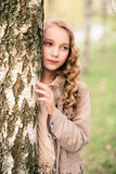 Portrait of girl standing close to tree Royalty Free Stock Photos