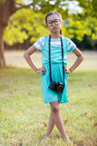 Portrait of girl standing with hand on hip. In park Stock Photos