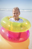 Portrait of girl standing in inflatable rings Stock Photos