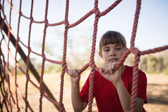 Portrait of girl standing near net during obstacle course. In boot camp royalty free stock photography