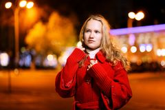 Portrait of a girl standing on the street of the evening city. royalty free stock images