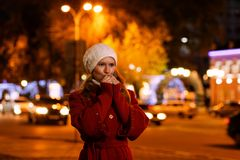 Portrait of a girl standing on the street of the evening city. royalty free stock photos