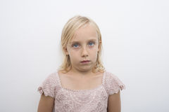 Portrait of girl staring over white background Royalty Free Stock Photo