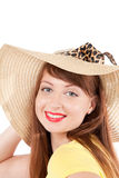 Portrait of the girl in a straw hat. Portrait of the young smiling girl in a straw hat on a white background royalty free stock images