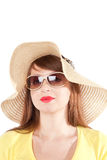 Portrait of the girl in a straw hat. Portrait of the young smiling girl in a straw hat on a white background royalty free stock photos