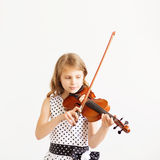 Portrait of girl with string and playing violin. Stock Photos