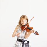 Portrait of girl with string and playing violin Stock Photos