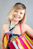Portrait of girl with striped bag Stock Photography