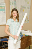 Portrait of a girl student with drawings on a roll Stock Photography