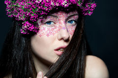 Portrait girl with stylish make-up and flowers Royalty Free Stock Photo