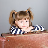 Portrait of the girl with suitcases Royalty Free Stock Images