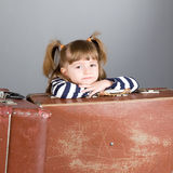 Portrait of the girl with suitcases Royalty Free Stock Photos