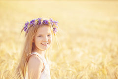 Portrait of girl at summer wheat field Royalty Free Stock Image