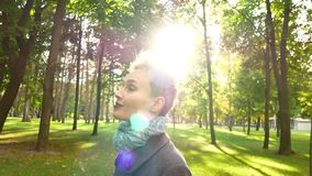 Portrait of a girl in the sun. Walk in the autumn park. Portrait of a girl in the sun. Walk in the autumn park stock video footage