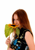 Portrait of girl with sunflower. Stock Photo