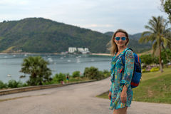 Portrait of a girl in sunglasses and a tunic of the sea and the Royalty Free Stock Photo