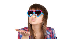 Portrait girl in sunglasseses sends air kiss Stock Image
