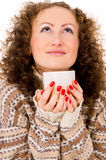 Portrait of a girl in a sweater with a mug of tea Royalty Free Stock Images