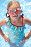 Portrait Of Girl In Swimming Pool. During Summer Stock Photo