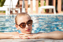 Portrait of girl in swimming pool. Stock Image