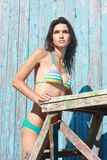 Portrait girl in swimsuit stands near building Royalty Free Stock Images