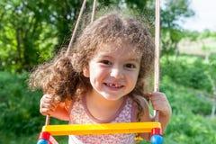 Portrait of girl on swing Stock Image