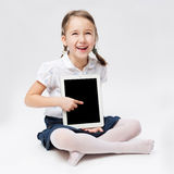 Portrait of girl with tablet Stock Photography