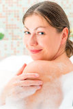 Portrait of a girl taking a bath with foam Royalty Free Stock Images
