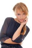 Portrait girl teenager holds hand near cheeks Royalty Free Stock Photos