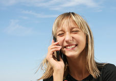Portrait of the  girl with telephone Stock Images
