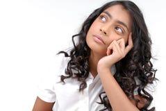 Portrait of girl thinking. Portrait of Indian girl thinking  on white Stock Photos