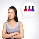 Portrait of  girl thinking about buying cosmetics Royalty Free Stock Photos
