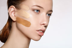 Portrait of girl with three kinds foundation on the face Stock Photography