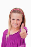 Portrait of a girl with the thumb up Stock Photo
