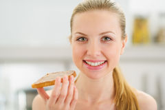 Portrait of girl with toast with chocolate cream Stock Photos