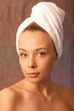 Portrait of the girl with a towel. On a head Royalty Free Stock Photography