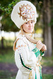 Portrait of girl in traditional festive attire, steppe nomad peoples, outdoors. Royalty Free Stock Photo