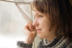 Portrait of Girl in train looks out of window Stock Images