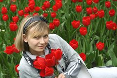 Portrait of girl in tulips Stock Photo